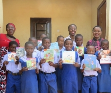 PUPILS OF CENTRAL PRIMARY SCHOOL EKE WITH PRESENTED BOOKS