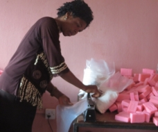 A beneficiary of Enterprising Women in her Home Soap factory