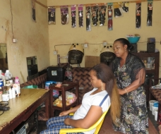 A beneficiary of Enterprising Women in her beauty saloon